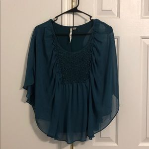 Teal colored butterfly sleeved top